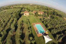 Ferienwohnung in Bibbona - Bilocale con piscina immerso nel verde...